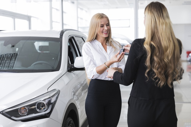 woman-receiving-new-car-s-key_23-2148266071.jpg